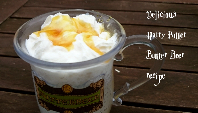 butter-beer-tankard-on-table-with-cream-and-sauce-topping-with-writing