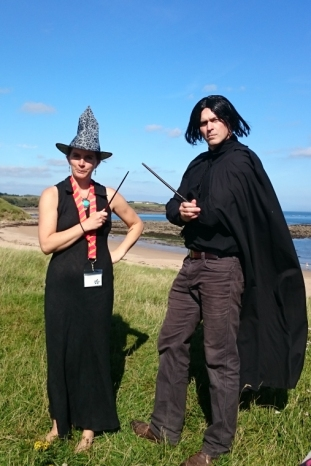 couple-overlooking-beach-in-witch-outfits-mcgonogall-and-snape-costume