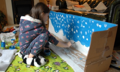 girl-painting-snow-onto-a-box-scene
