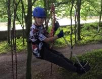 boy-in-climbing-harness-in-tree