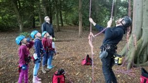 children-being-given-demonstration-with-climbing-ropes-at-bottom-of-tree