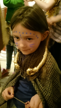 girl-dressing-in-woollen-robe-with-golden-necklace-and-woad-face-paints