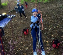 girl-in-climbing-harness-in-tree