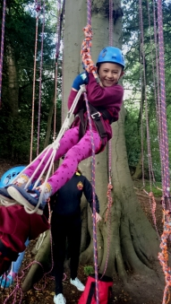 girl-in-standing-position-in-climbing-harness