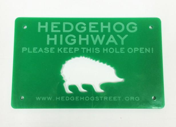 Green label with hedgehog picture stating 'Hedgehog Highway'