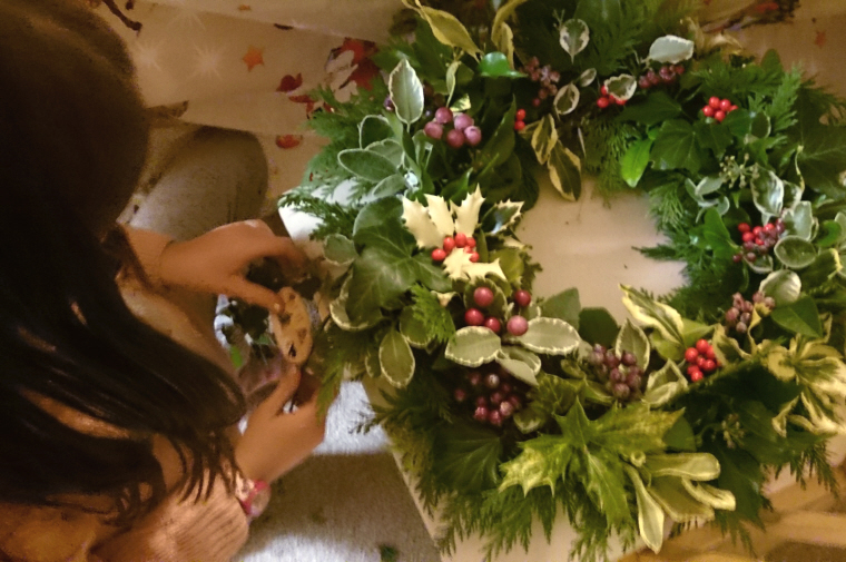 girl-with-completed-evergreen-wreath