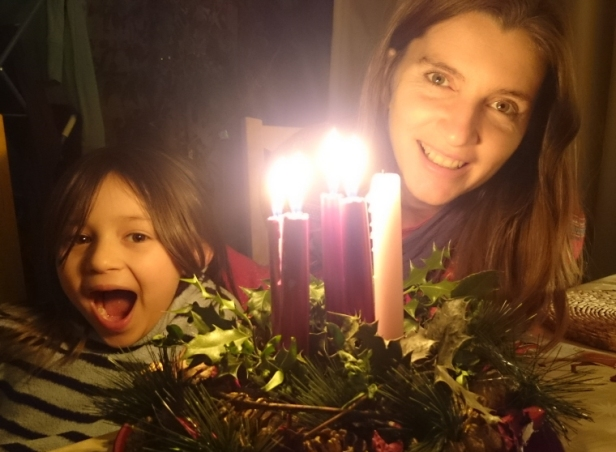 woman-and-child-with-candle-lit-advent-wreath-close-up