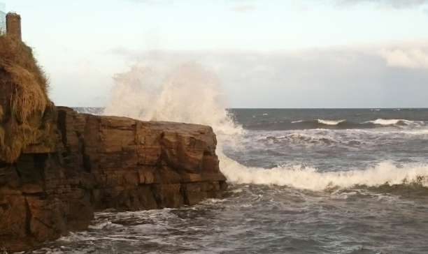 wave-crashing-over-rocks