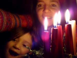 woman-and-child-behind-4-lit-candles