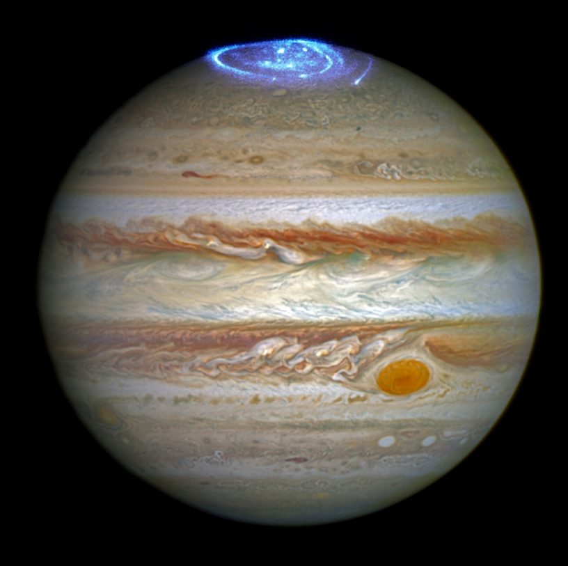 planet-jupiter-photo-by-juno-space-probe-showing-blue-atmosphere-at-the-pole-and-red-storm