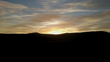 sunset-over-silhouetted-hills