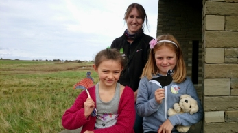 woman-and-two-girls-on-wall-with-holding-craft-ducks-in-front-of-heathland