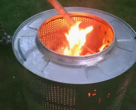close-up-of-burning-firepit-in-a-washing-machine-drum