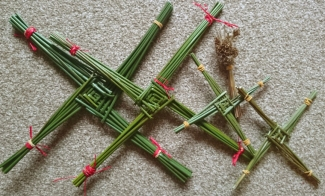 close-up-of-several-brigids-crosses-made-from-fresh-reeds