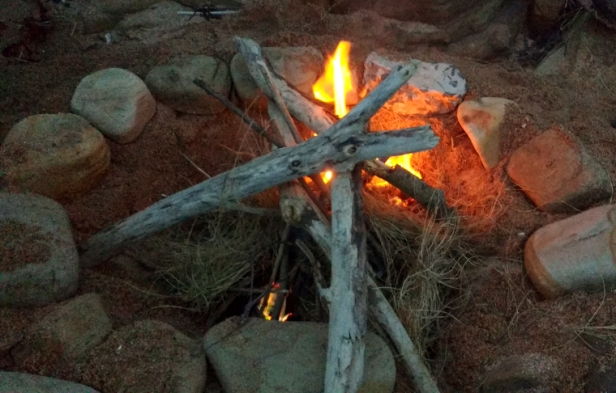 tipi-of-sticks-campfire-in-circle-of-rocks