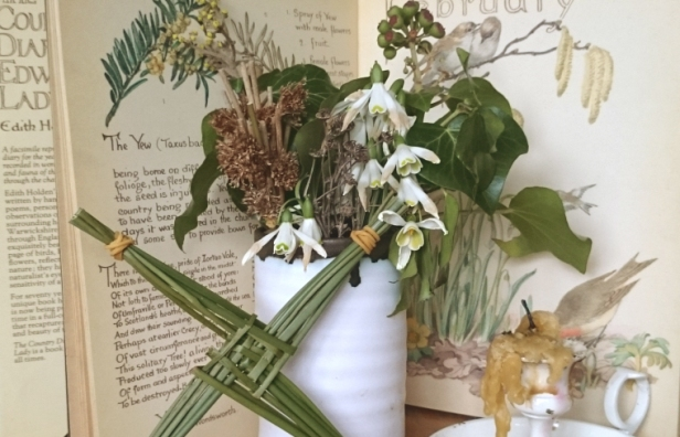 vase-of-snowdrops-with-candle-and-brigids-reed-cross