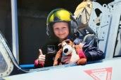 Girl in helmet in open cockpit