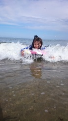 Girl on bodayboard with white water in sea